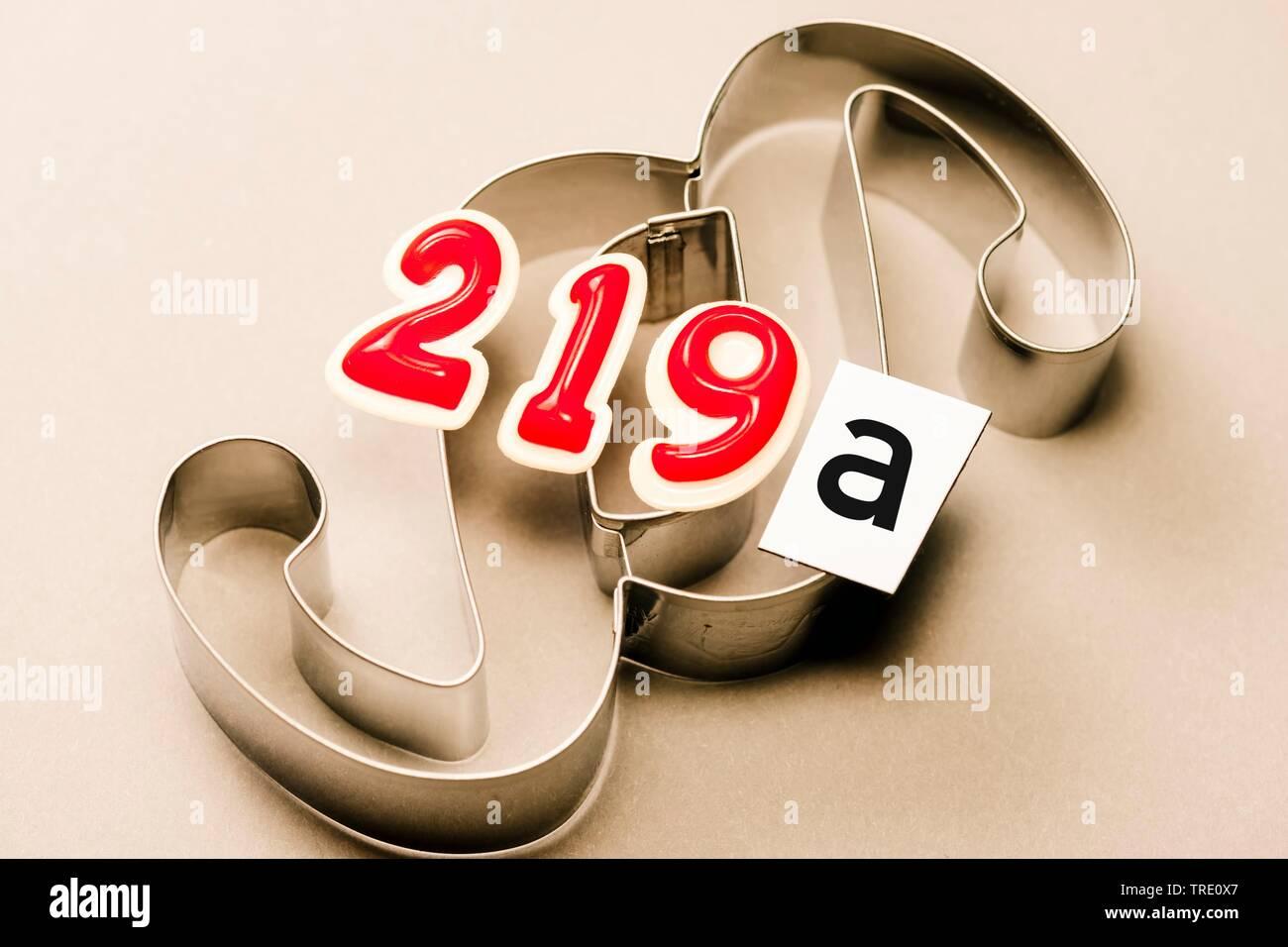 Symbolbild fuer den Paragraph § 219a - Werbung fuer den Abbruch der Schwangerschaft | Symbol for paragraph § 219a of the German criminal code - Advert - Stock Image