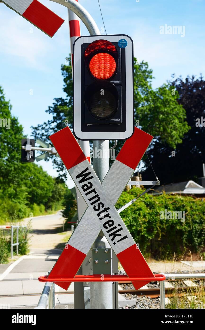 Closed railway crossing lettering WARNSTREIK (warning strike) symbolizing rail strike, Germany Stock Photo