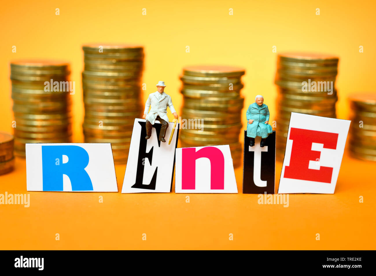 figures with stacks of Euro coins and the word Rente, retirement provision, Germany Stock Photo