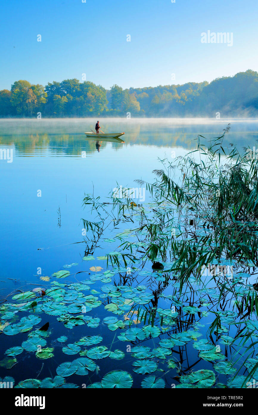 Angler auf dem Burgaeschisee, Schweiz, Solothurn | angler on lake Burgaeschisee, Switzerland, Solothurn | BLWS517989.jpg [ (c) blickwinkel/P. Frischkn - Stock Image