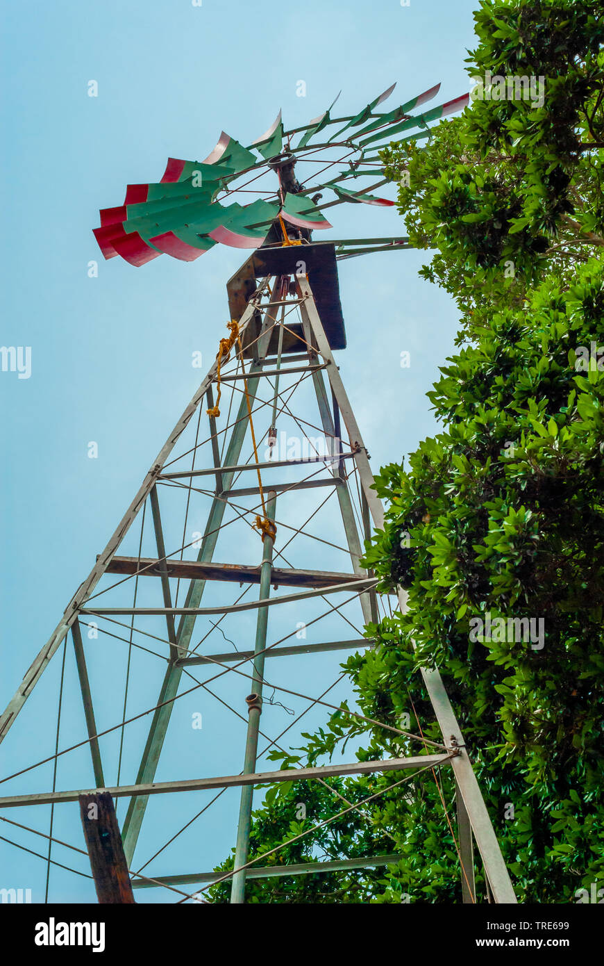 Windmill, with green blades, used for water extraction, taken from Tecoh, in the Yucatan peninsula - Stock Image