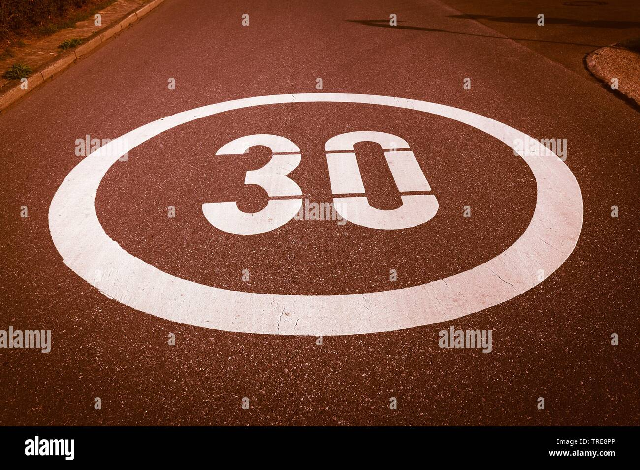 mark on asphalt, speed limit of 30 km/h, Germany Stock Photo