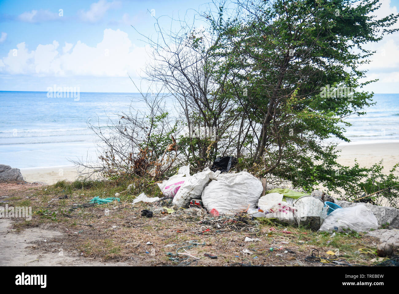 Garbage in the sea with bag plastic bottle and other garbage beach sandy dirty sea on the island / Environmental problem of plastic rubbish pollution - Stock Image