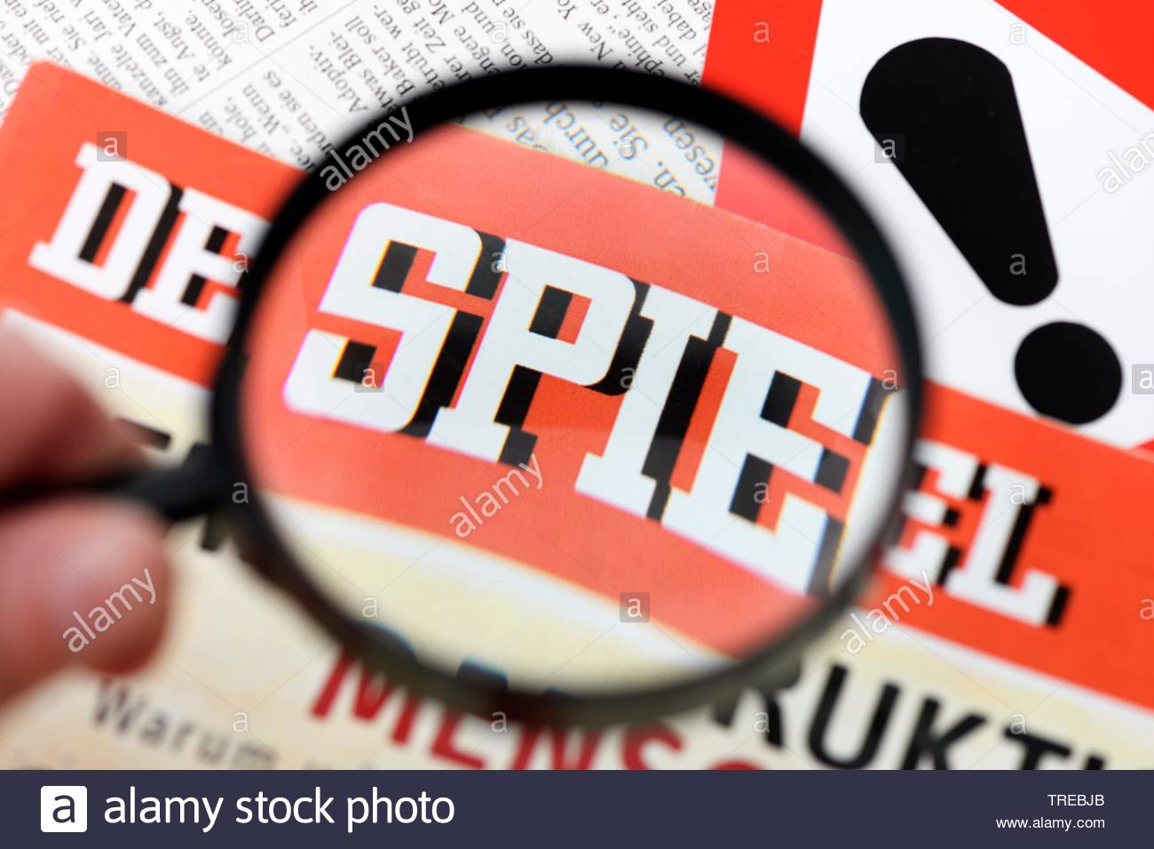 The German news magazine DER SPIEGEL under a magnifying glass - fake stories Stock Photo