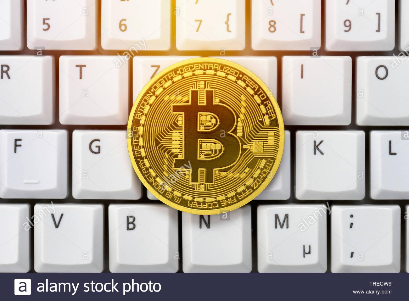 Bitcoin on a keyboard Stock Photo