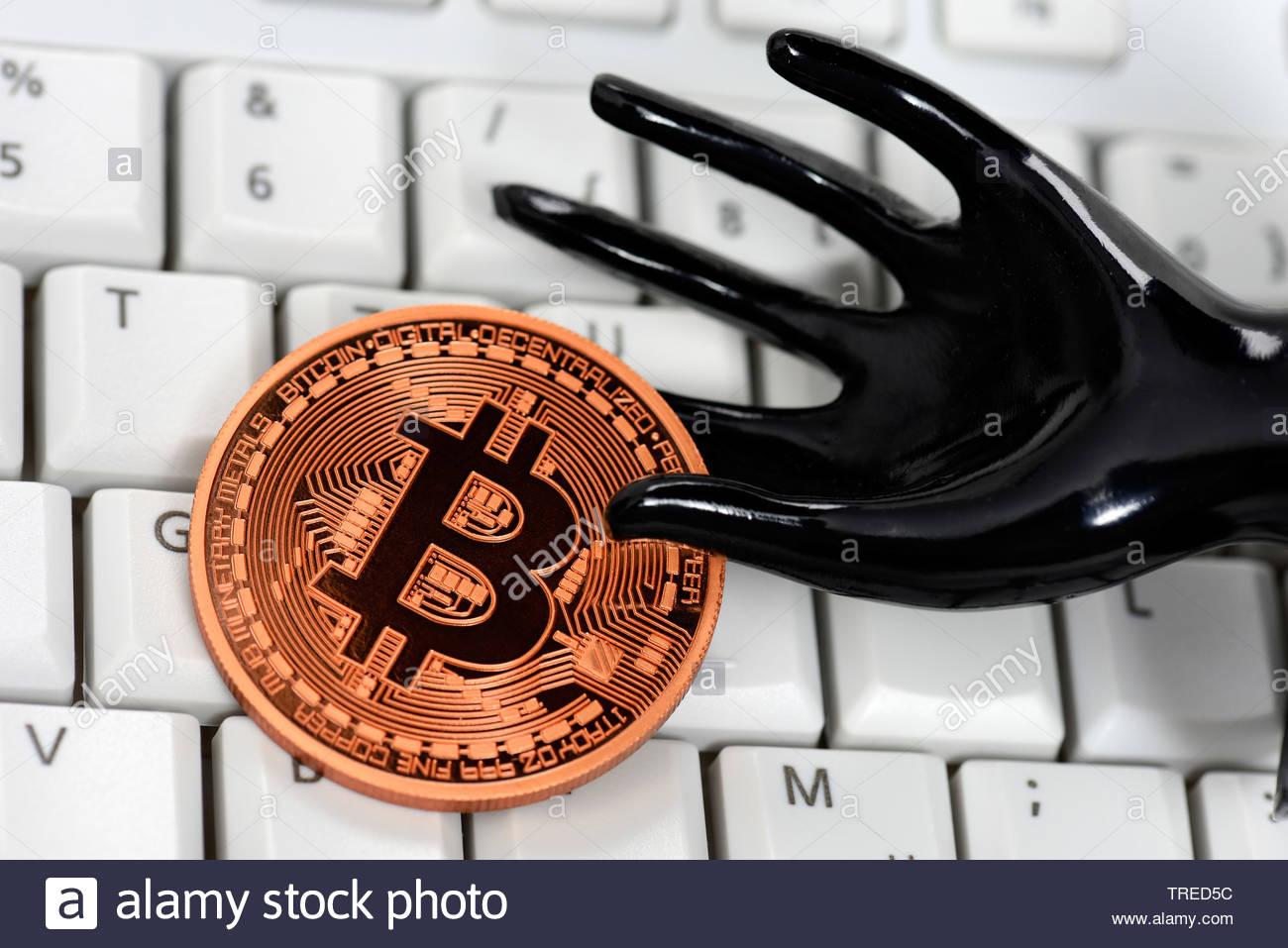 Bitcoin-Muenze auf einer Tastatur | Bitcoin on a keyboard | BLWS523400.jpg [ (c) blickwinkel/McPHOTO/C. Ohde Tel. +49 (0)2302-2793220, E-mail: info@bl - Stock Image