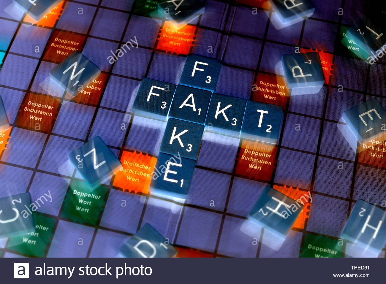 FAKE FAKT als Woerter in einem Scrabble Spiel dargestellt | FAKE FAKT (fake fact) shown as letters on a scrabble play board | BLWS523415.jpg [ (c) bli - Stock Image