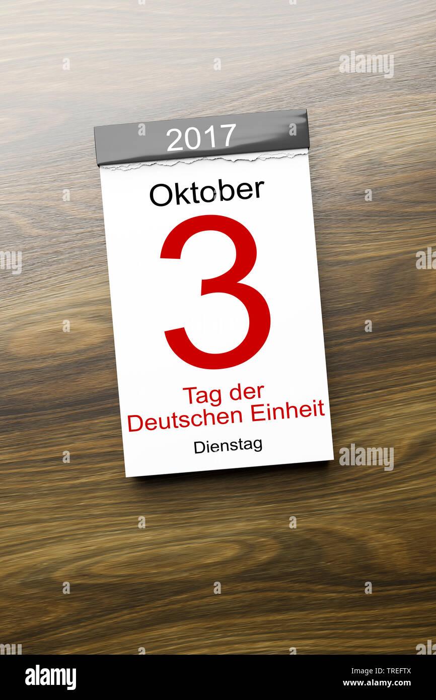 Abreisskalender mit Aufschrift 3 OKTOBER 2017 TAG DER DEUTSCHEN EINHEIT | Tear-off calendar lettering 3 OKTOBER 2017 TAG DER DEUTSCHEN EINHEIT (Octobe - Stock Image