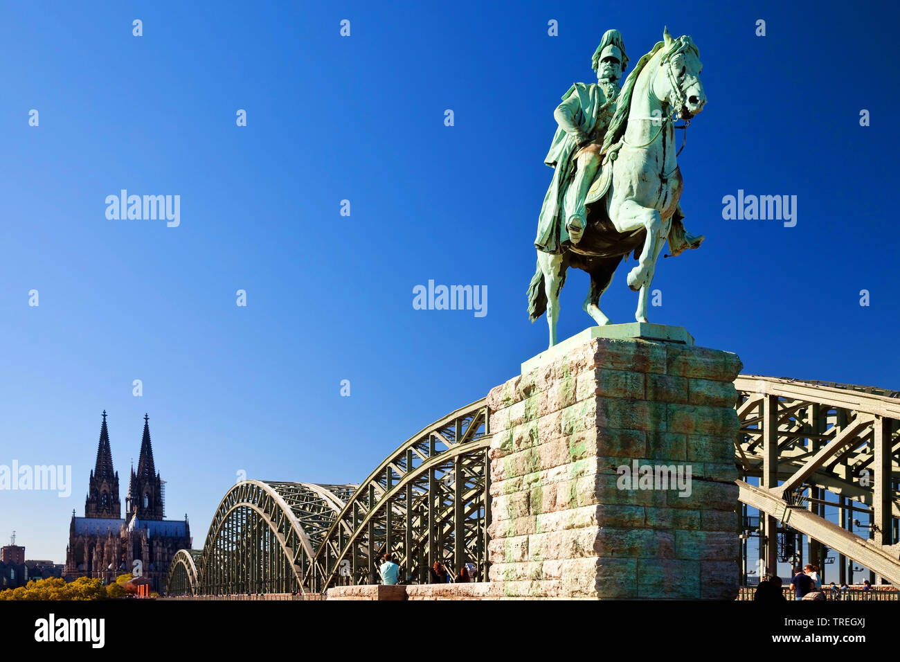 Equestrian Statue of Wilhelm I. with Cologne Cathedral and Hohenzollern Bridge, Germany, North Rhine-Westphalia, Cologne Stock Photo