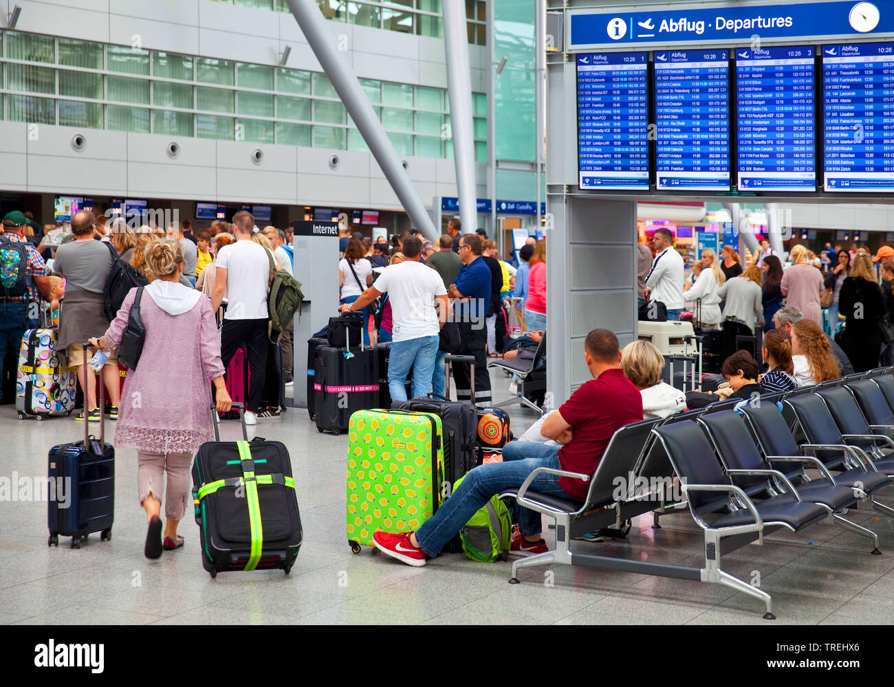 airport terminal with many people during the holiday season , Germany, North Rhine-Westphalia, Duesseldorf Stock Photo