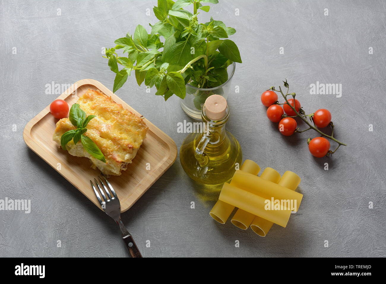 Cannelloni pasta stuffed with spinach, mushrooms,ricotta and sauce bechamel. Italian cuisine. Traditional food for Shavuot Jewish holiday - Stock Image