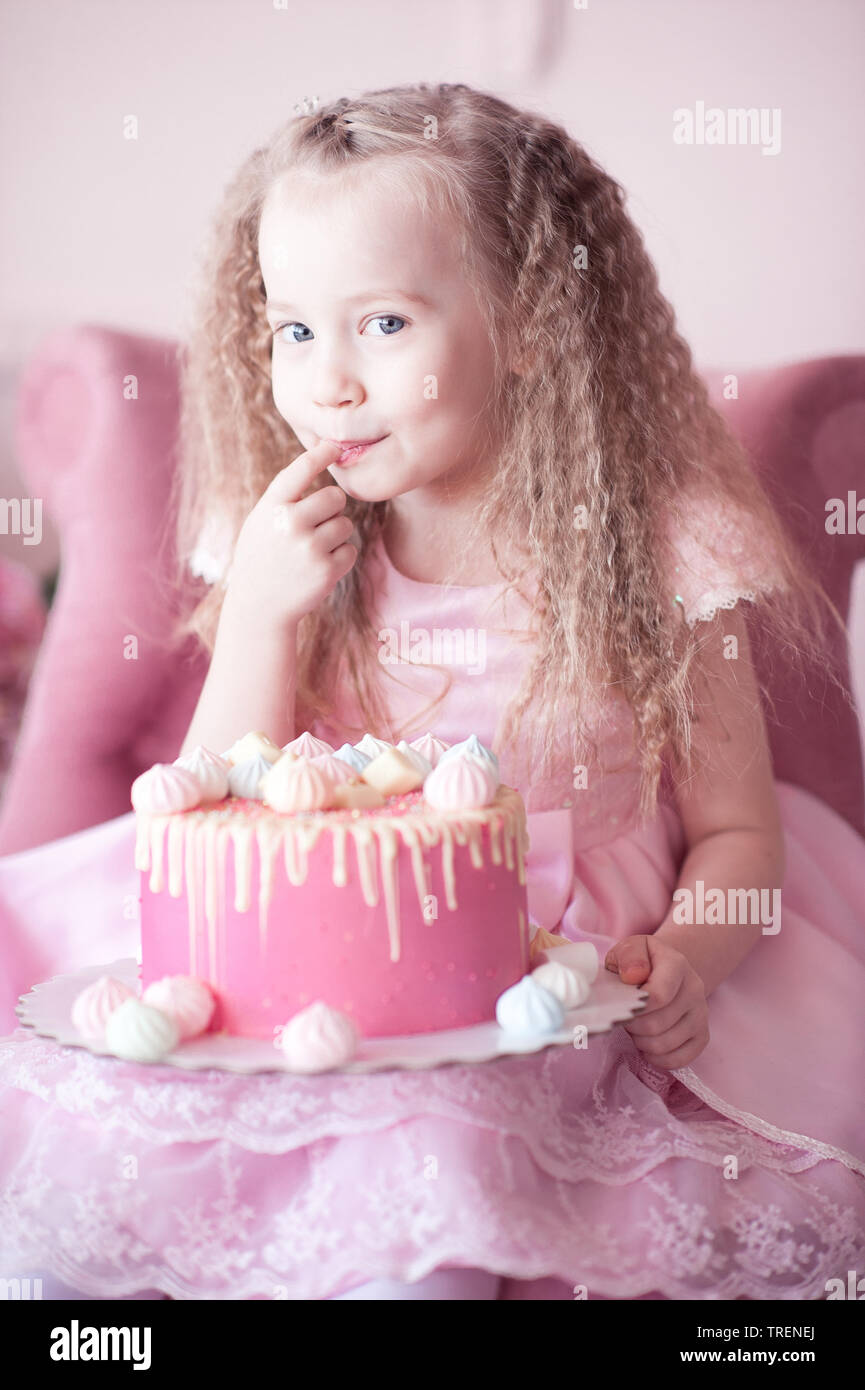 Sensational Cute Baby Girl 4 5 Year Old Eating Cake With Finger Sitting In Personalised Birthday Cards Akebfashionlily Jamesorg