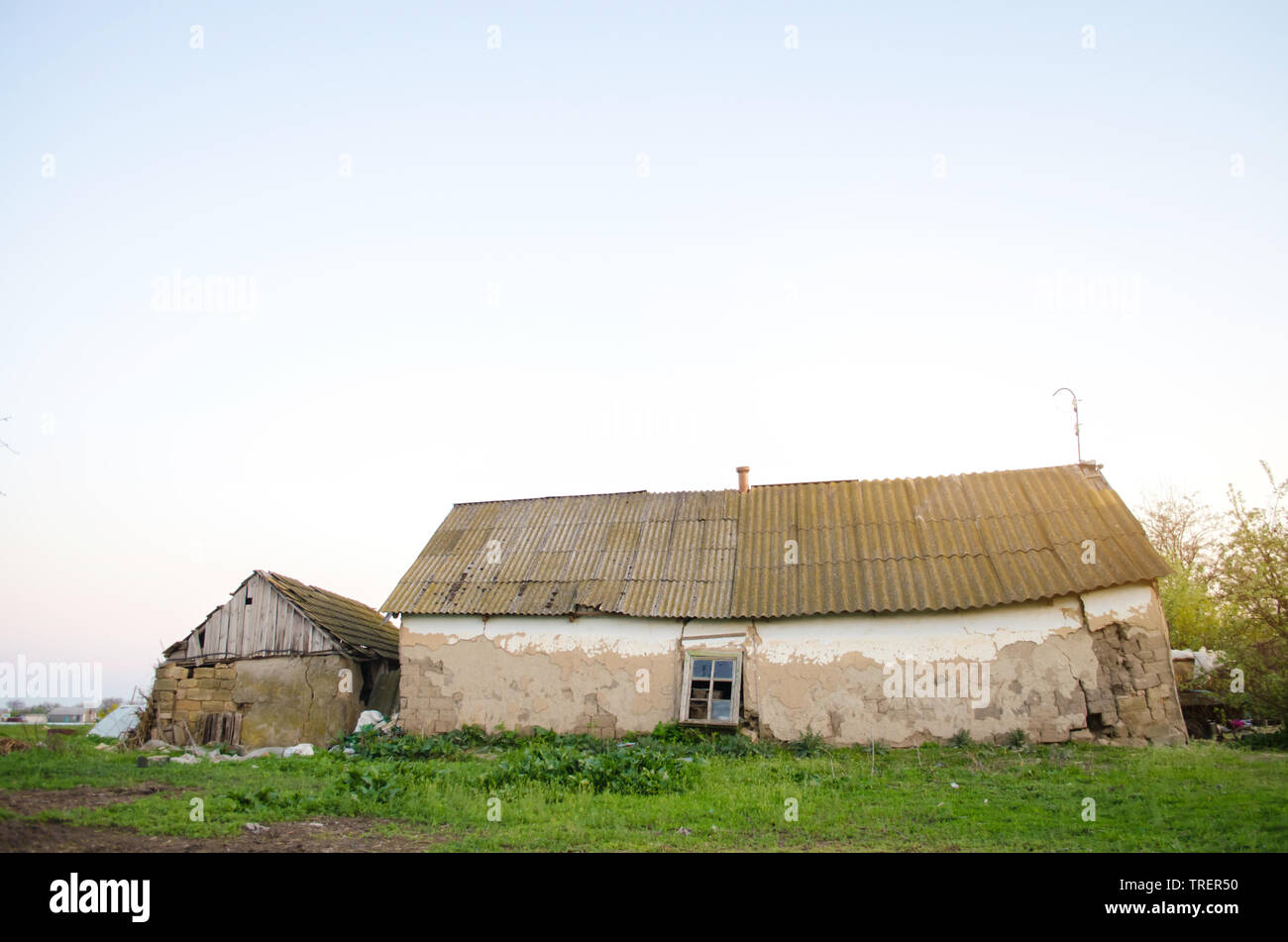 Old ruined house in the countryside. Emergency housing. Disaster. Storm hurricane flood earthquake. Demolition of old buildings. Dangerous home - Stock Image