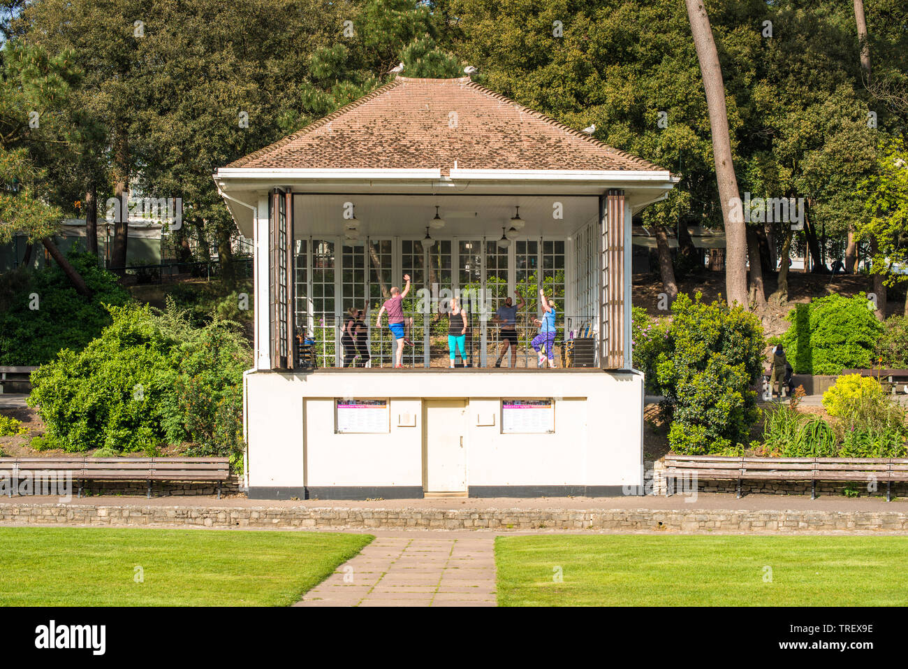 An aerobics class taking place in the Bandstand on the Lower Gardens in Bournemouth, Dorset, England, UK. - Stock Image