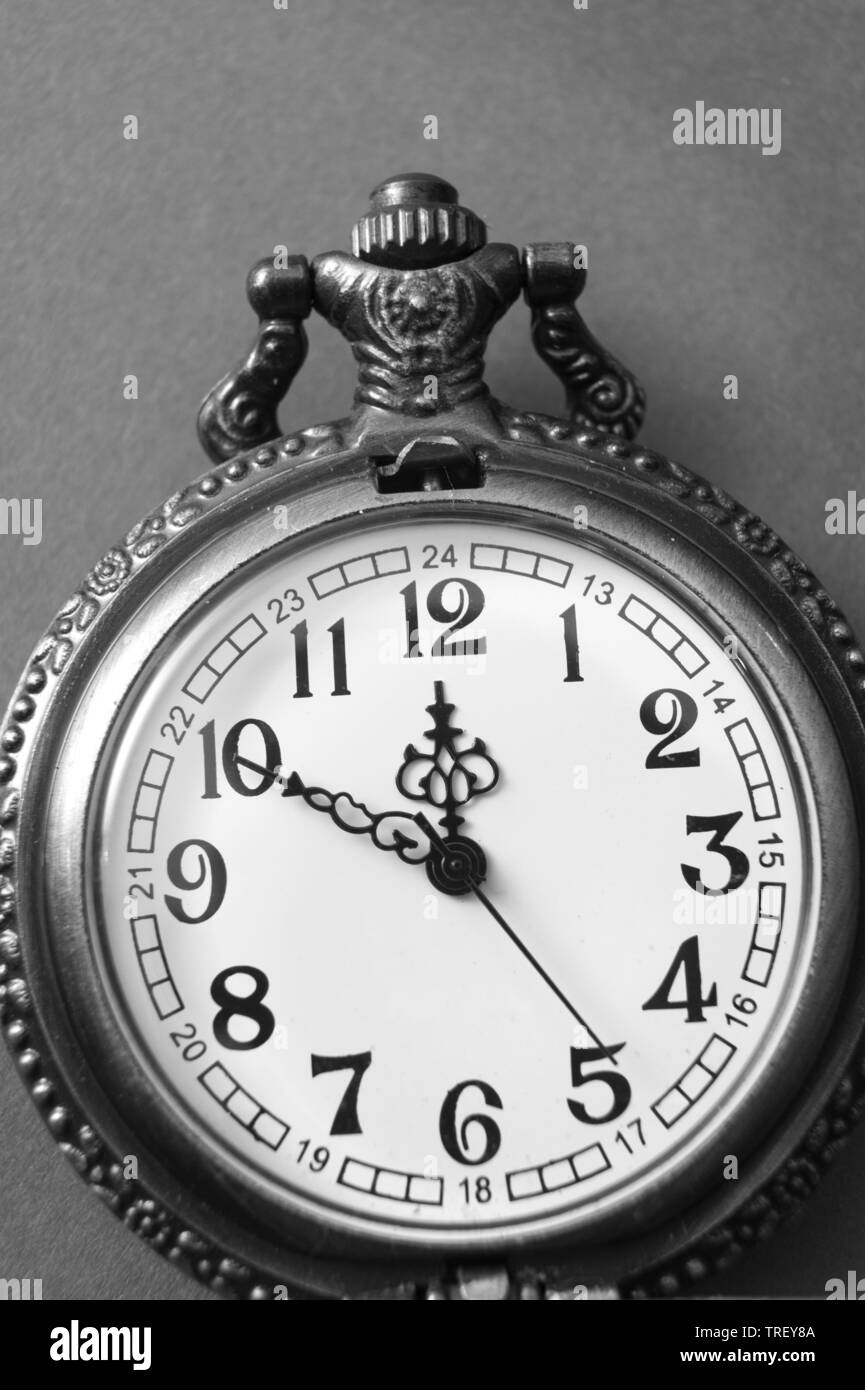 black and white photo of  open pocket watch, from above - Stock Image