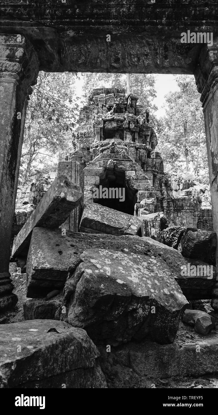Ruined architectural heritage of Ta Prohm ancient temple complex with old scattered stones and rock. (Angkor Wat, UNESCO, Siem Reap, Cambodia) - Stock Image