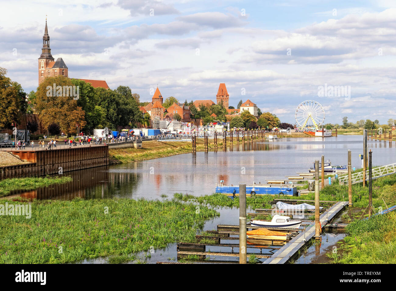 Tangermuende, Saxony Anhalt/ GERMANY May 12 2019: Cityscape of Tangermuende with its Stephan cathedral with harbor. People having un on a fair. Stock Photo