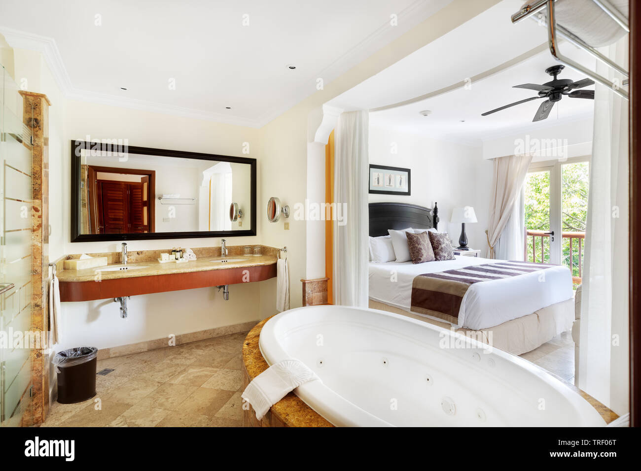 A hotel room at the all-inclusive, adult only resort, Valentin Imperial Maya. The room features a Jacuzzi tub, balcony and plenty of space. - Stock Image