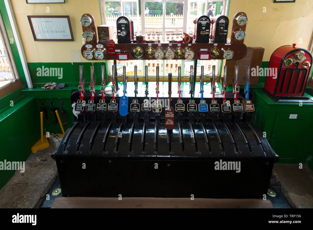 Leavers on the mechanical lever frame inside the signal box at Haven Street station on the Isle of Wight steam Railway. UK. (99) - Stock Image
