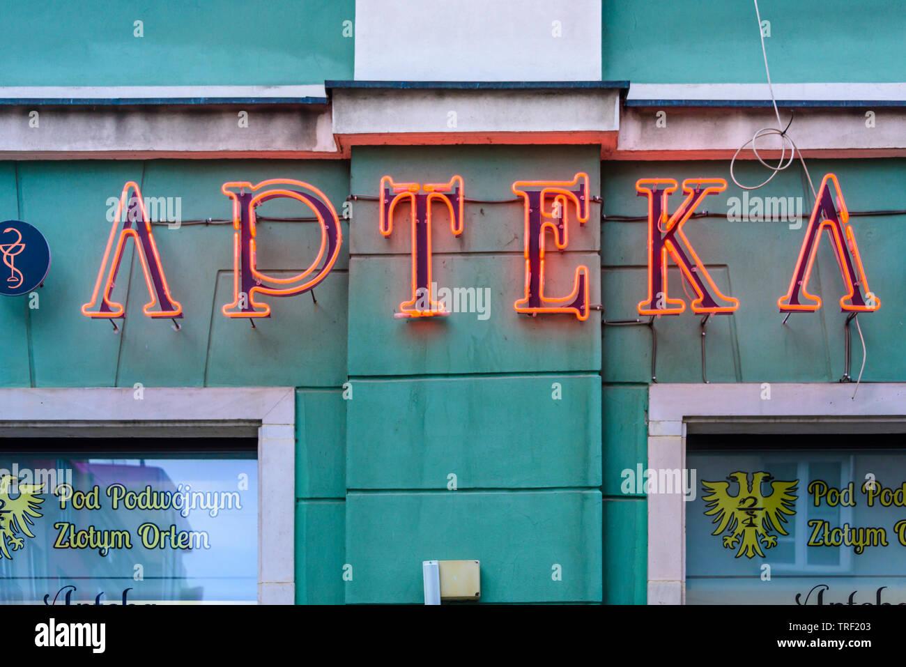 Neon sign saying 'Apteka' outside a pharmacy chemists shop, Wrocław, Wroclaw, Wroklaw, Poland - Stock Image