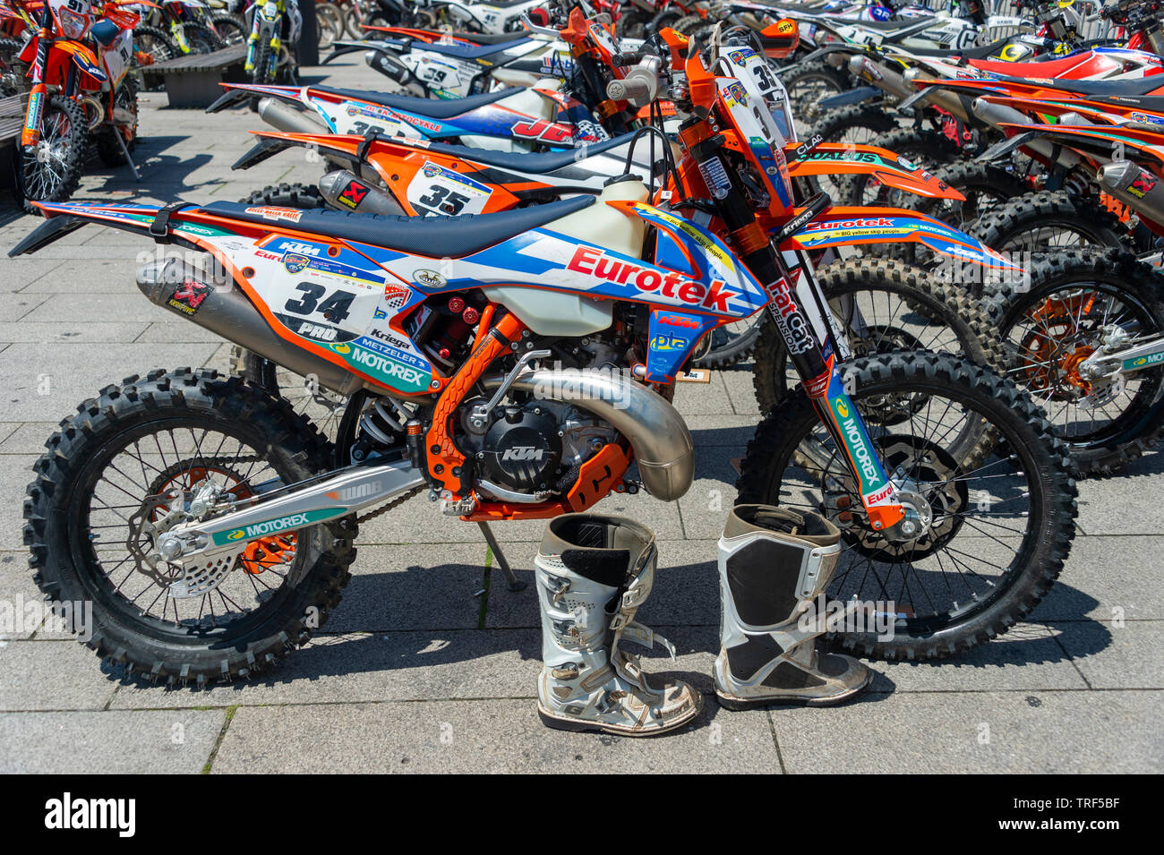 KTM motocross enduro competition​ bikes parked in the paddock at world enduro event Porto, Portugal - Stock Image