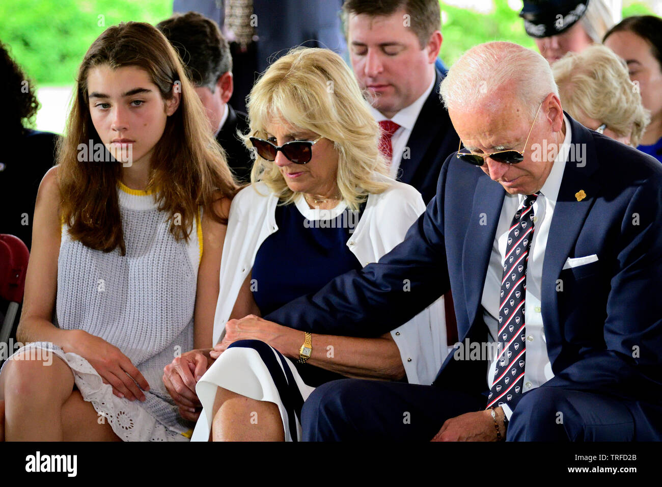 Former Vice President Joe Biden With Dr Jill Biden And Granddaughter Natalie Biden Bow Heads In Prayer During The Delaware Memorial Day Ceremony In Stock Photo Alamy