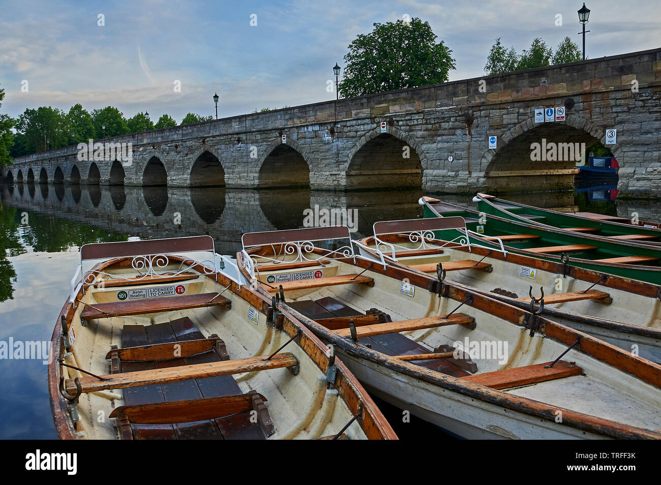 Stratford upon Avon, Warwickshire and boats moored on the River Avon early on a summer morning. - Stock Image