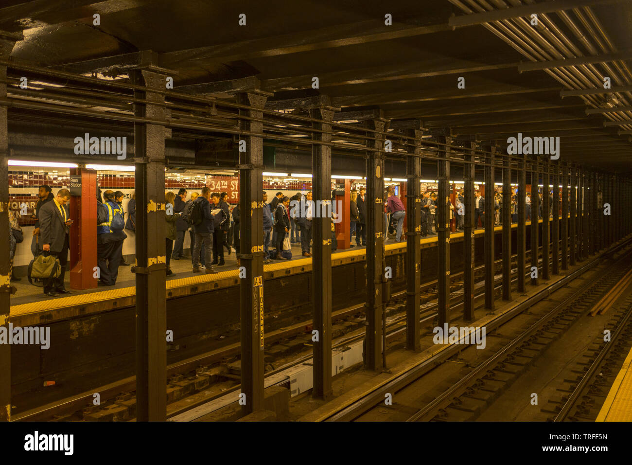 People waiting for a subway train at the 34th Street Penn Station stop in Manhattan. Stock Photo