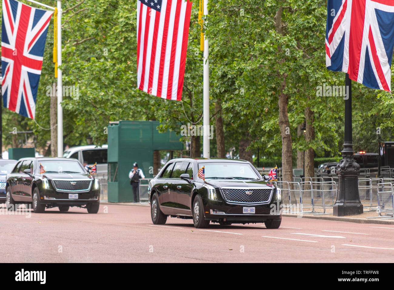 US President Donald Trump being driven along The Mall, London, UK in The Beast car with few people watching. No fans. Presidential motorcade - Stock Image