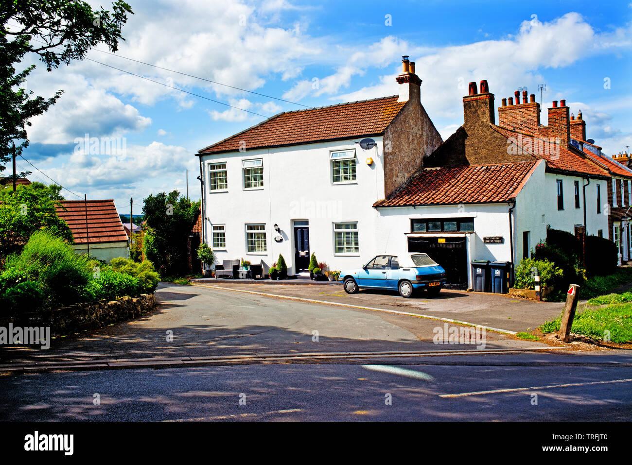 Period house and Peugeot 205 convertible car, Sadberge, Borough of Darlington, England Stock Photo