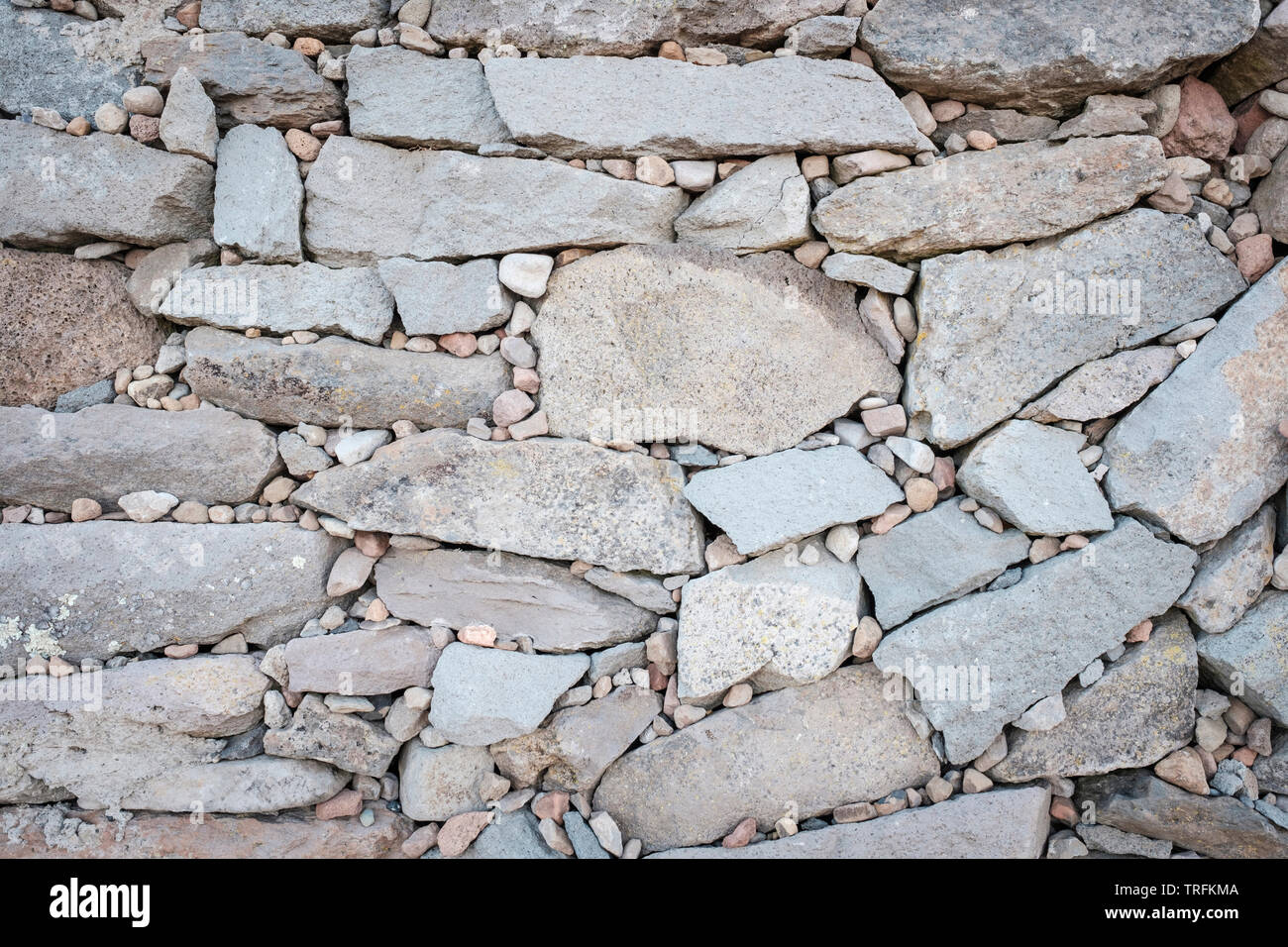 Detail of the small stones for wishes and good omens at Pachamama or Mother Earth Temple wall, Amantani Island, Puno Region, Peru - Stock Image