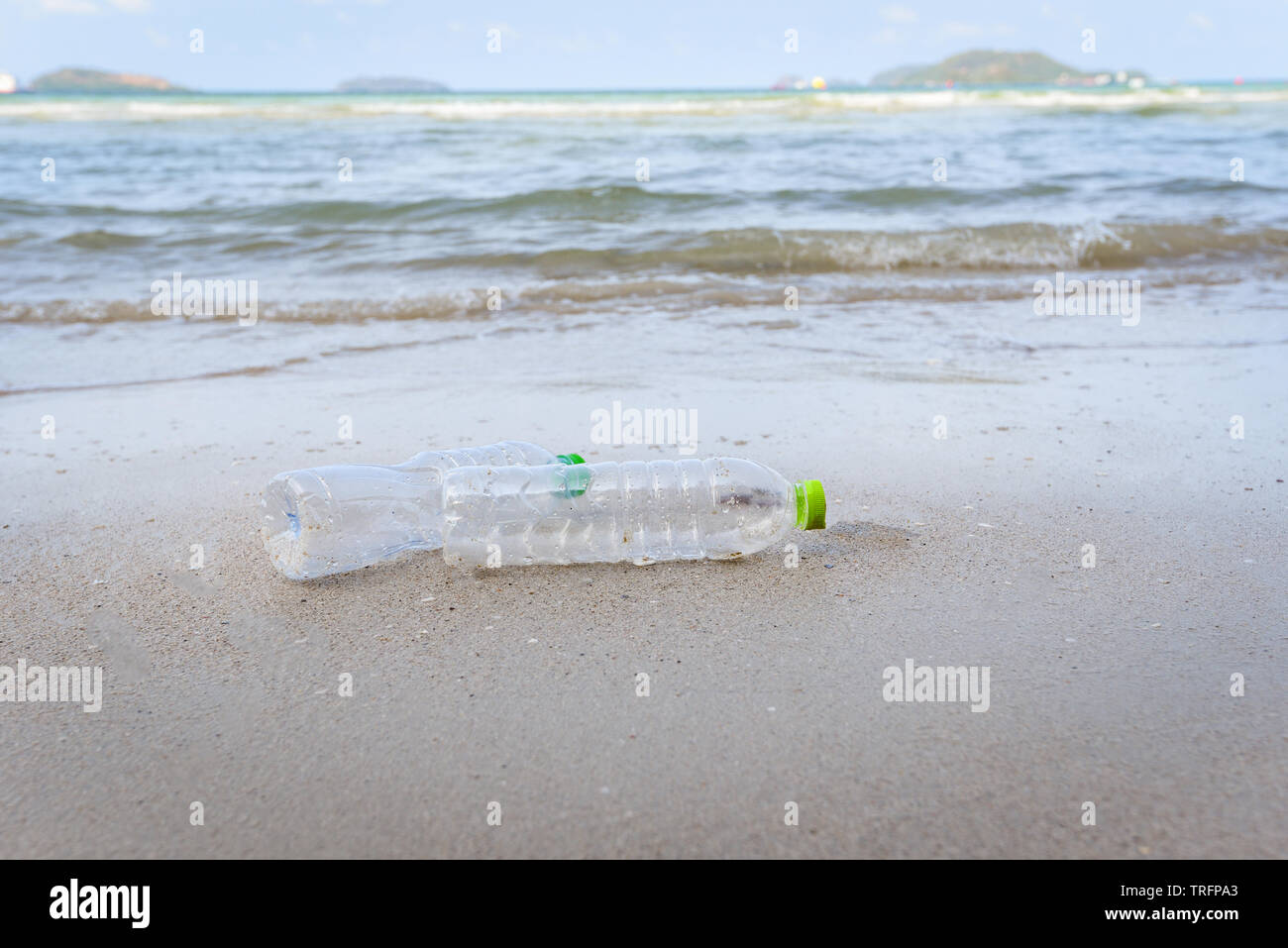 Garbage in the sea with plastic bottle on beach sandy dirty sea on the island / Environmental problem of plastic rubbish pollution in ocean - Stock Image