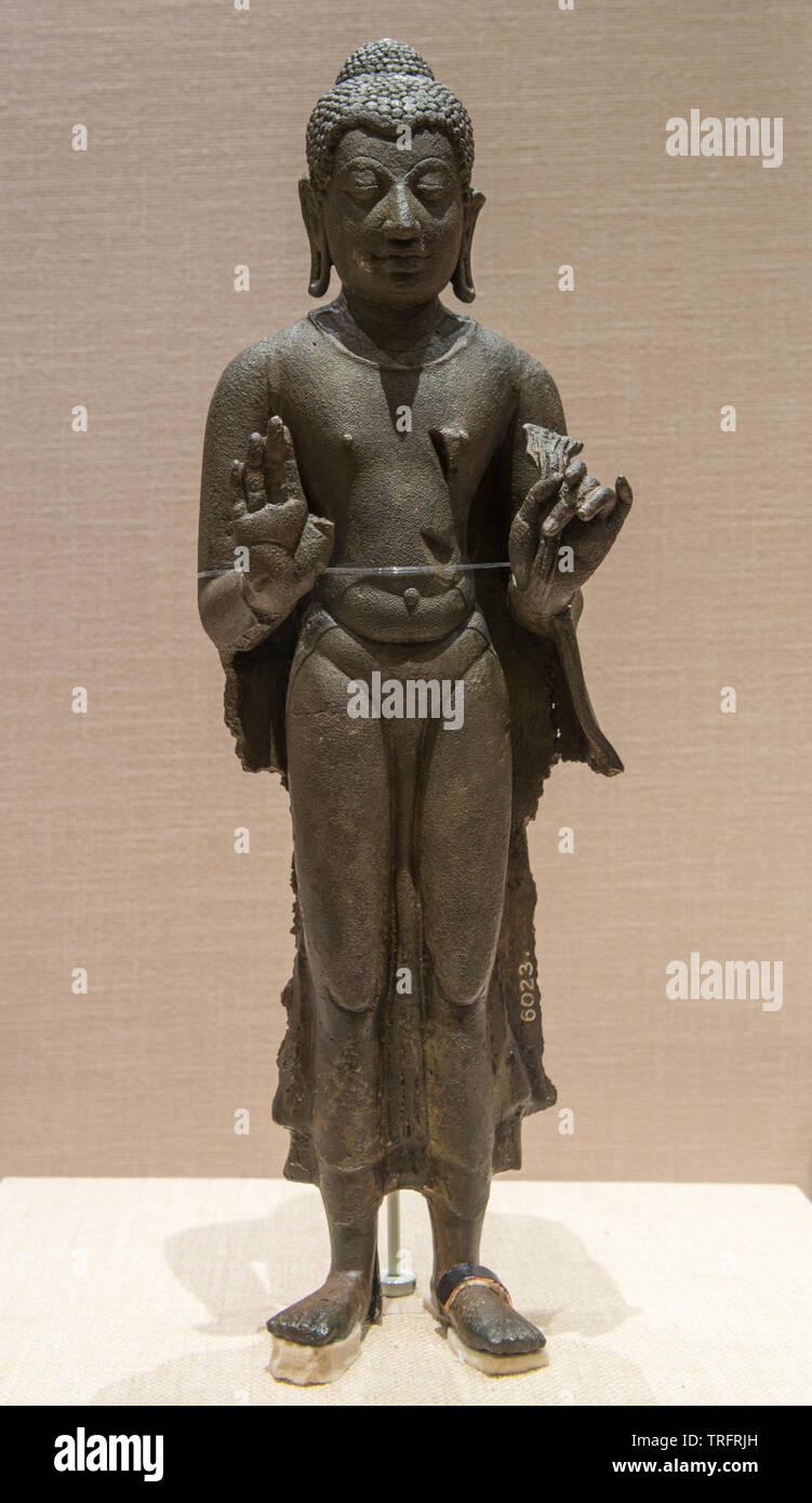 Copper Buddha statue. 8nd-9nd Century. Embouchure of Komering, Palembang, South Sumatra. National Museum of Indonesia - Stock Image