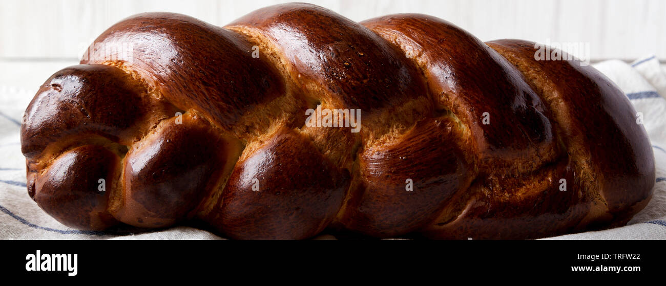 Homemade jewish challah bread, side view. Close-up. - Stock Image