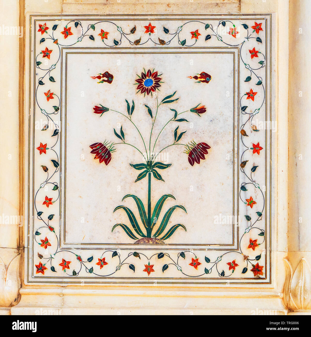 Delicate flower motifs made of coloured marble inlays in white marble adorning the Rang Mahal pavilion of the Red Fort complex in Delhi Northern India - Stock Image