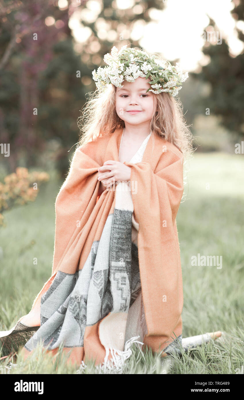 Stylish baby girl 6-6 year old wearing trendy poncho outdoors