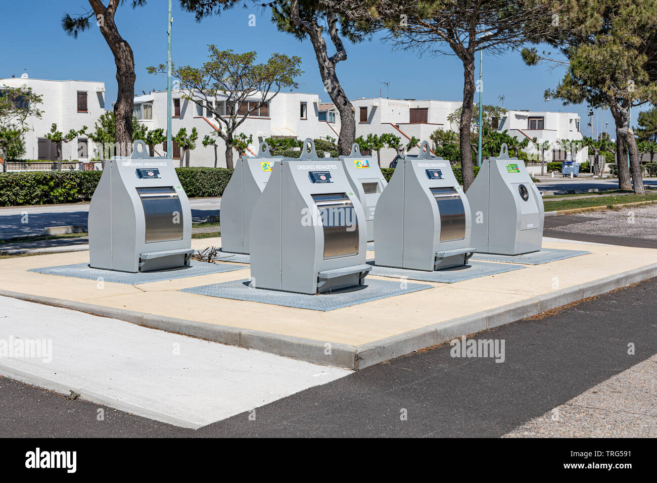 Refuse and recycling bins in Le Barcares, South of France - Stock Image