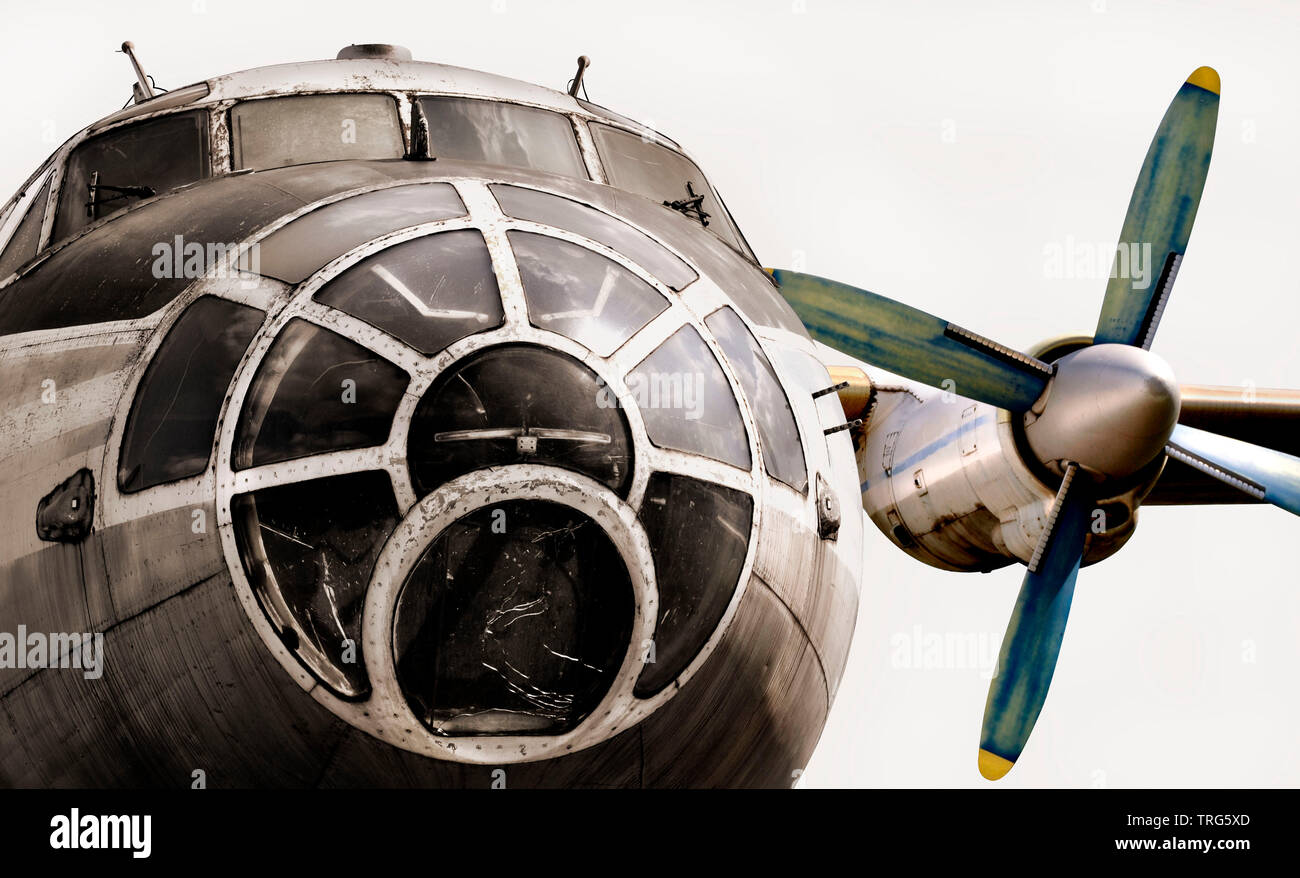 Old plane isolated. The nose of the aircraft, cockpit and aircraft engine. - Stock Image