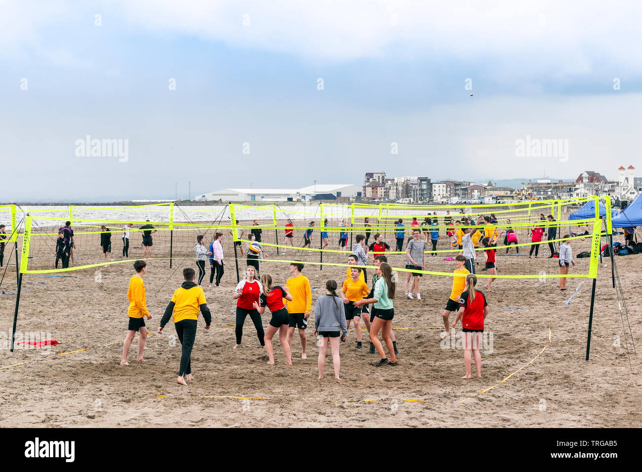 Ayr, UK, Scottish Volleyball Association organised the first school's beach volleyball competition held in Scotland, where 180 secondary school children, aged over 13 years, forming 40 teams from across the West of Scotland were invited to take part. The competition, won by  St Matthews Academy, Saltcoats (wearing yellow) was overseen by the members Scottish Volleyball Association who were hoping to identify potential future international team players and put them on a pathway to success. Credit: Findlay/Alamy Live News Stock Photo
