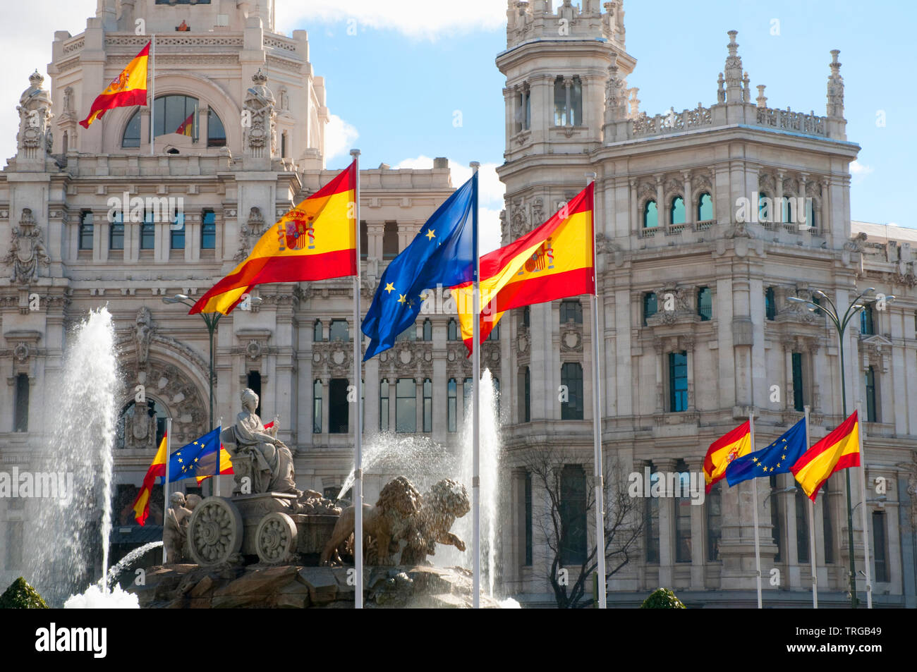 Cibeles fountain with European and Spanish flags commemorating the Spanish Presidency of European Union. Madrid, Spain. - Stock Image