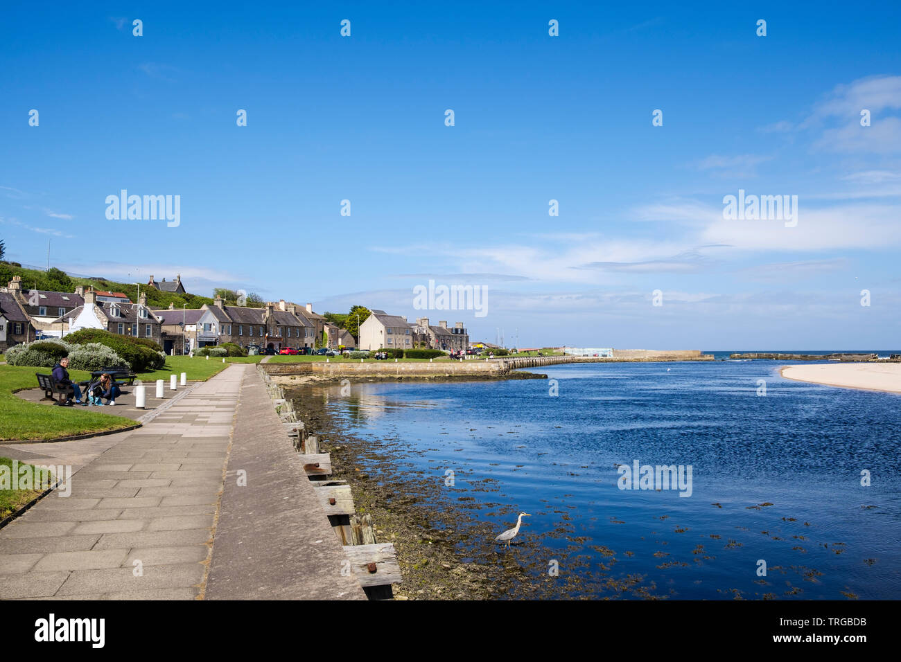 View along waterfront promenade beside Lossie River mouth on Moray Firth coast. Lossiemouth, Moray, Scotland, UK, Britain - Stock Image