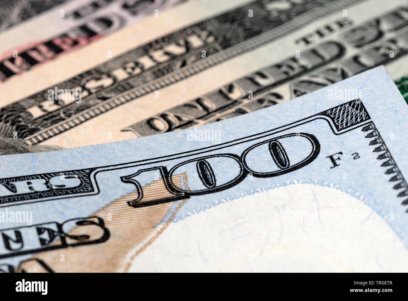 Fragment of a hundred dollar bill closeup. Shallow depth of field - Stock Image