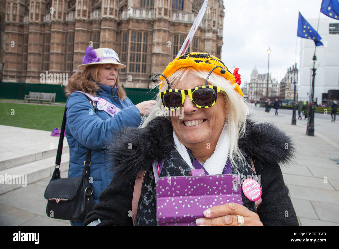 London, UK. 13 March, 2019. Protesters for the group Women Against State Pension Inequality (WASPI) gather at the House of Parliament, Westminster to express their anger at the change of the pension age for women born in 1950's. They call on the government to provide compensation for the millions of women affected by the change. Stock Photo