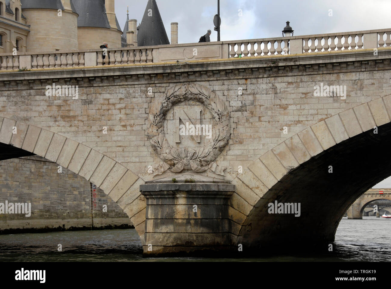 Pont au Change, Paris, France, with a large letter N in a circular wreath as part of the stonework - Stock Image