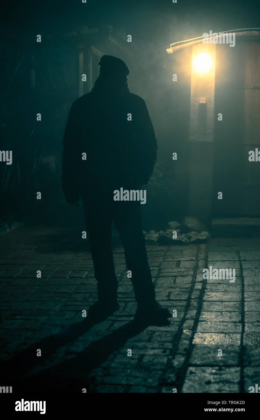 man silhouette and light at night - Stock Image