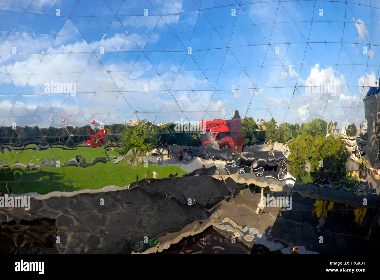 Reflections in a large geodesic dome near open area, Paris, France - Stock Image