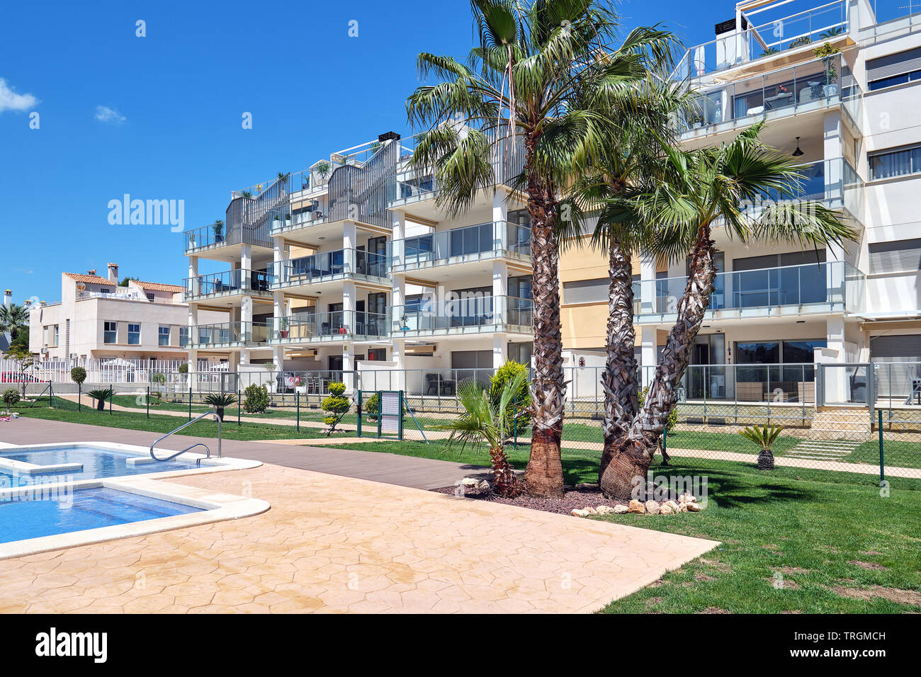 Torrevieja, Spain - April 24, 2019: High rise residential multi-storey house, closed urbanization with swimming pool area for sunbathing, no people - Stock Image