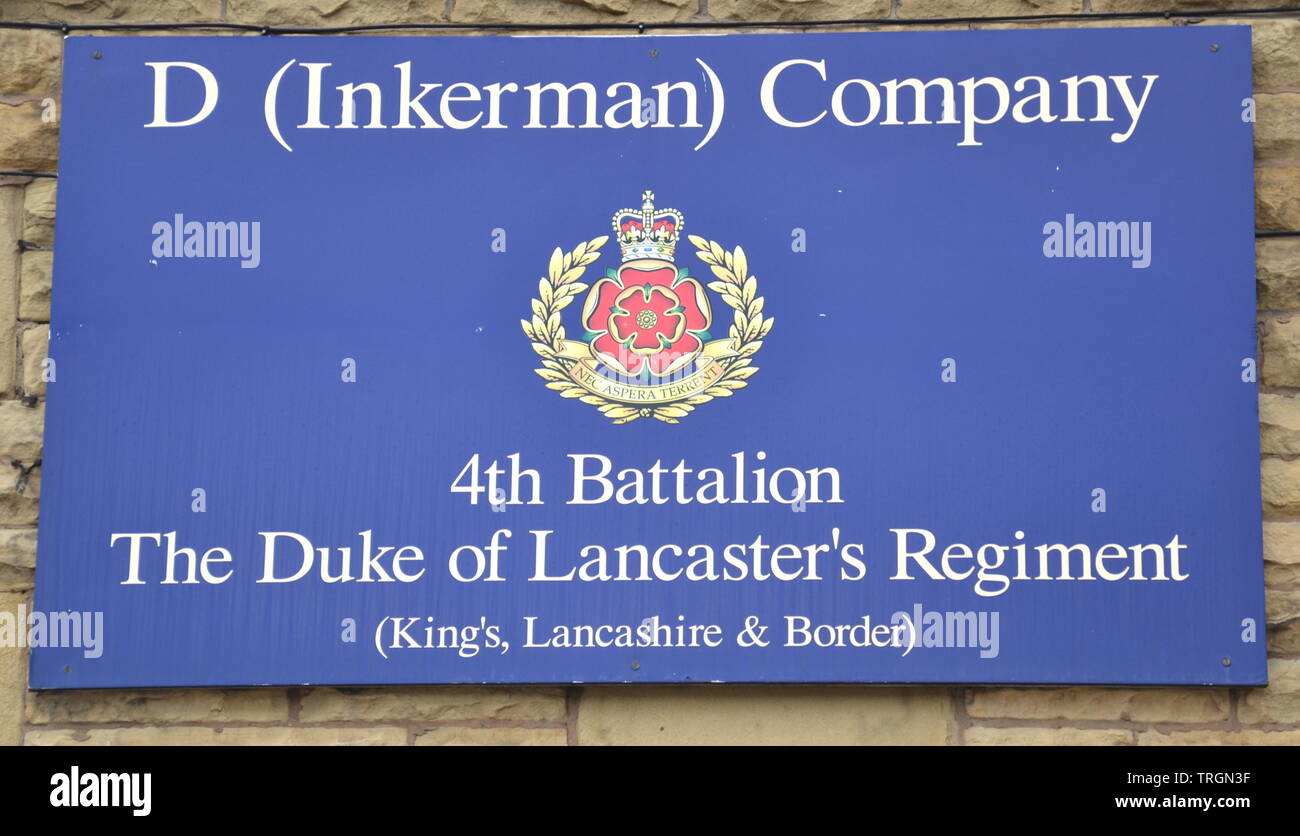 A sign for the Duke of Lancashire's Regiment Territorial Army in Ardwick, Manchester, uk - Stock Image
