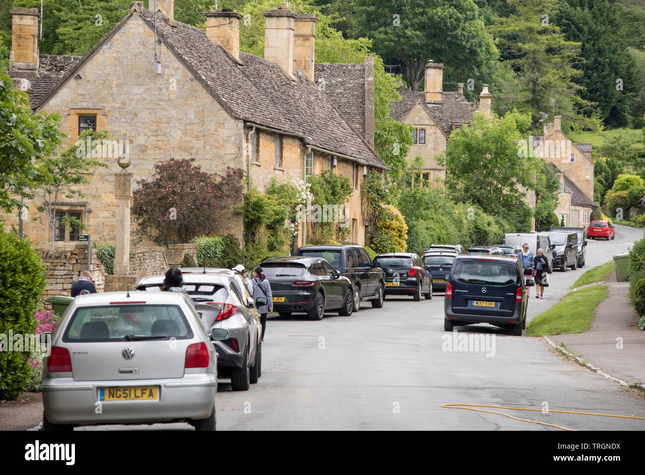 The Cotswold village of Stanway congested with parked cars, Worcestershire, England, UK Stock Photo