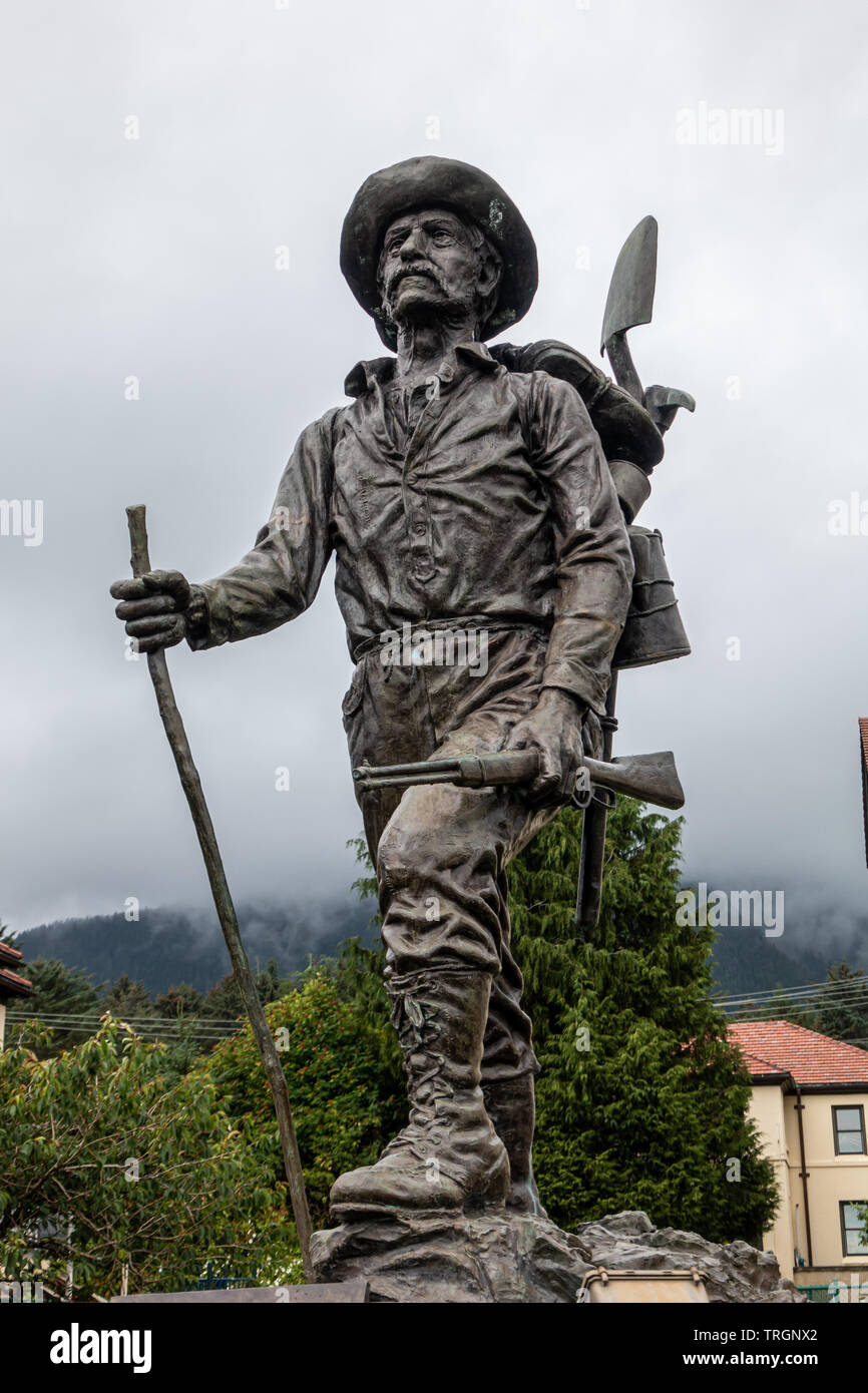 Bronze Prospector Statue in Front of Pioneers Home in Sitka, Alaska - Stock Image